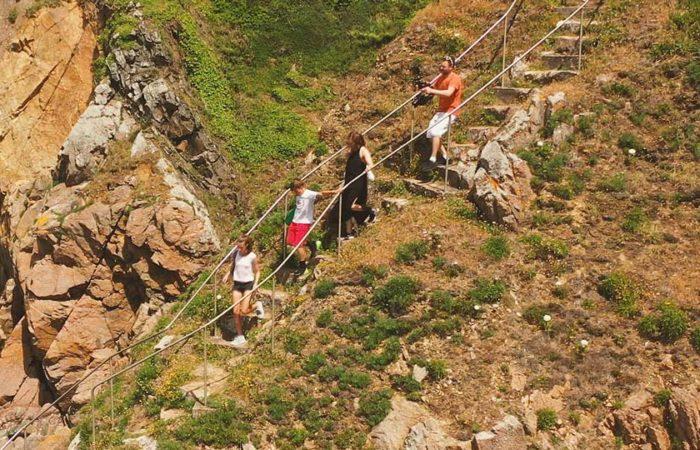 James Harrison Filmmaker Guernsey on cliff steps