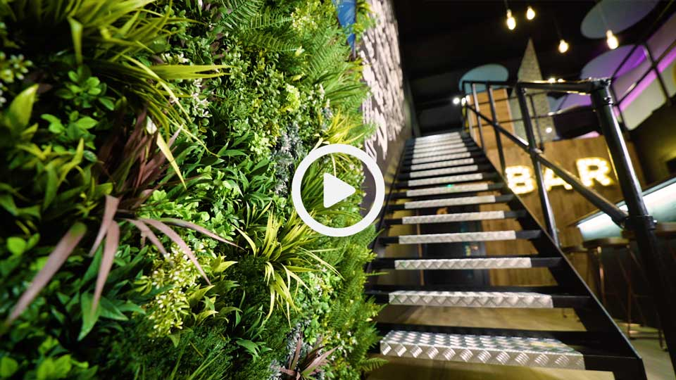 metal staircase and foliage in a showroom