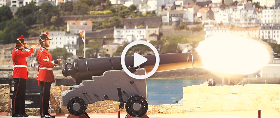 two men firing guernsey's noonday gun at midday