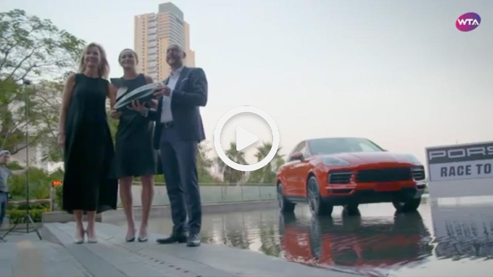 three people stood next to a car